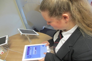 Kyia tests out the new online forum at Smiles House
