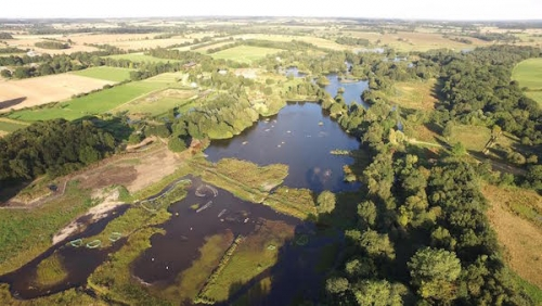 Pensthorpe Natural Park from the air, with early-stage work on creating the new reed beds taking place in the foreground.   Picture Credit: Pensthorpe Conservation Trust.
