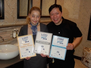 Mandy Ames Head Housekeeper and Erwin Mullari Housekeeping Assistant, with the awards certificates, in the refurbished lades' toilets near the Minstrel Suite function room.