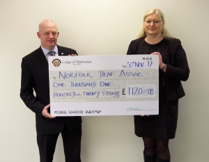 Nigel Hood from the Lodge of Marksmen and Aliona Derrett, CEO Norfolk Deaf association